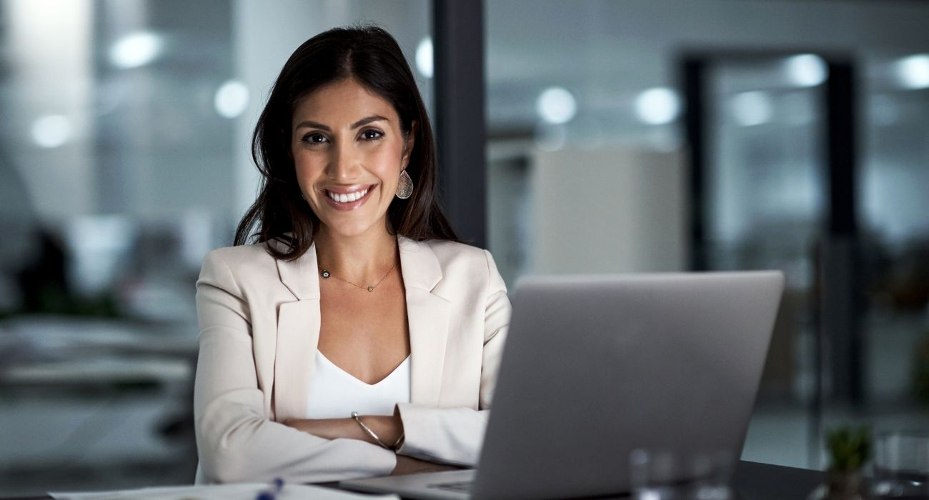 Portrait of a happy businesswoman working at her office desk